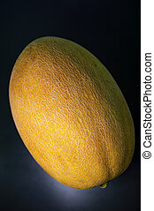 Yellow melon on a black background.