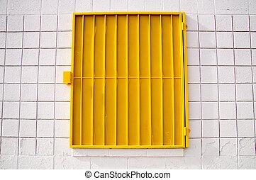 Yellow mesh shutter on white wall