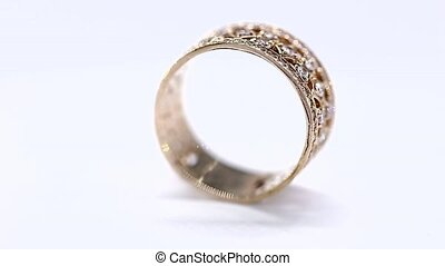 Yellow Metal Gold Diamond Ring Rotation Loop