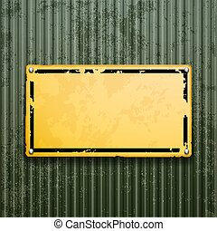 Yellow metal plate on grunge old surface. Industrial background.