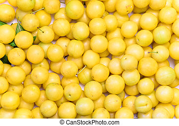 yellow mirabelle plums, background, texture - stock photo