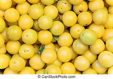 yellow mirabelle plums, background, texture