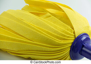 Yellow mop on white background.