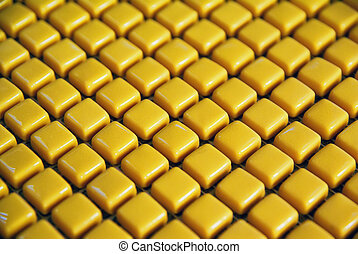 Yellow mosaic texture for abstract background