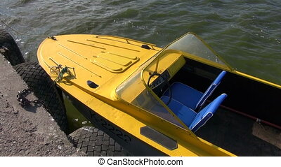 yellow motor boat on sea water