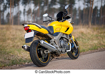 Yellow motorcycle on the road