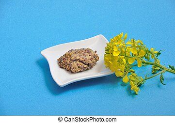 Yellow mustard flower and condiment