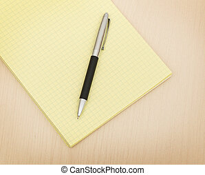yellow note book and pen