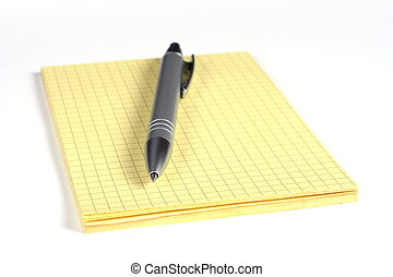 yellow notepad and pen on white background