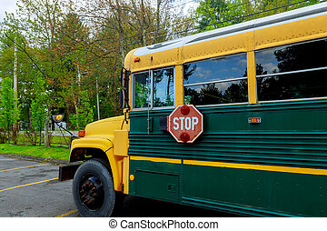 Yellow of school bus in sunny day on parked