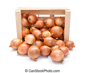Yellow onions in wooden crate
