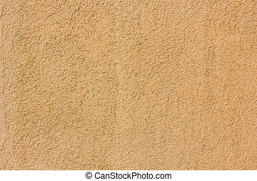 Yellow or orange concrete wall texture as a background. - ...