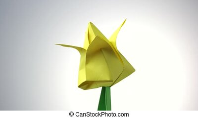 Yellow origami flower tulip. Traditional design of bulb....