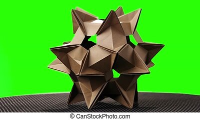 Blue origami transforming spiky ball. bright isolated background. | 183x300