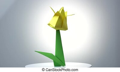 Yellow origami tulip flower. Beautiful spring plant made...