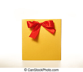 yellow paper gift bag with a Red Ribbon on white background