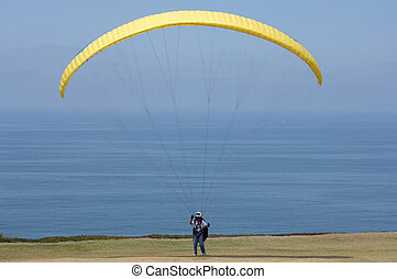 Yellow Parasail - Getting ready to parasail on the bluffs of...