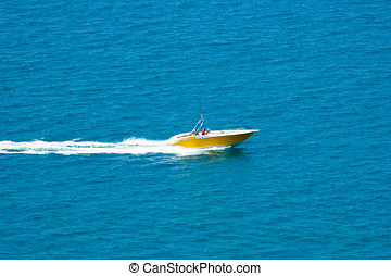yellow parasailing boat in the sea