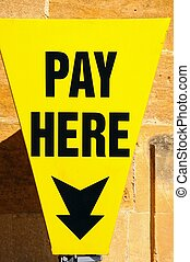 Yellow pay here sign.