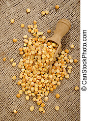 yellow pea on a wooden shovel