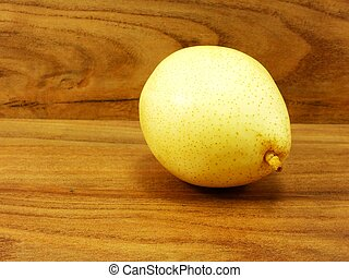 yellow pear on wooden background