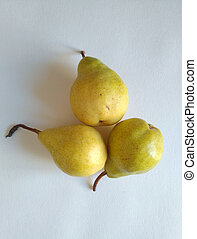 Yellow pears on a white background