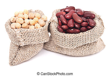 beans - yellow peas and red kidney beans in a sack on white...