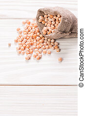 yellow peas, healthy food on wooden table