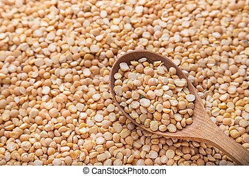 yellow peas in a spoon
