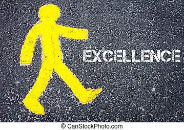 Yellow pedestrian figure walking towards EXCELLENCE