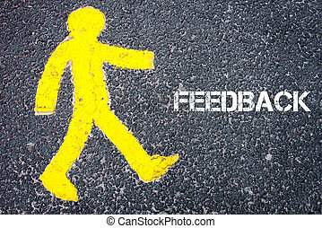 Yellow pedestrian figure walking towards FEEDBACK