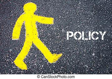 Yellow pedestrian figure walking towards POLICY