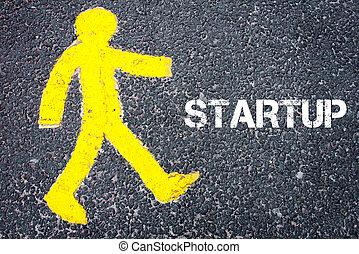 Yellow pedestrian figure walking towards STARTUP