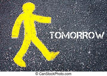 Yellow pedestrian figure walking towards TOMORROW