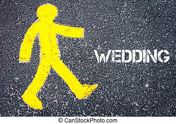 Yellow pedestrian figure walking towards WEDDING