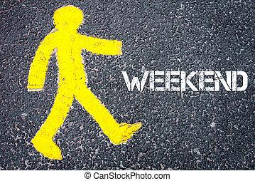 Yellow pedestrian figure walking towards WEEKEND