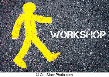 Yellow pedestrian figure walking towards WORKSHOP
