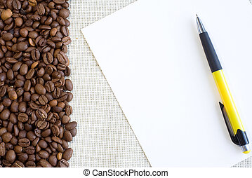 pen at paper sheet with coffee