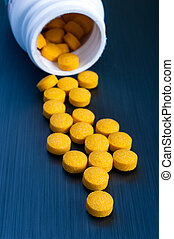 Yellow pharmaceutical pills