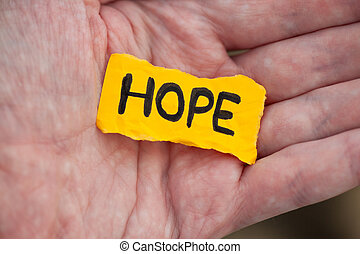 Yellow piece of paper with the word Hope