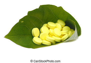 yellow pill in green leaf