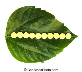 yellow pill over a green leaf