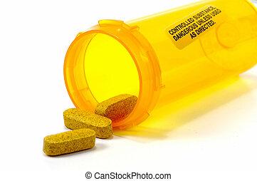Yellow Pills and a Pill Bottle