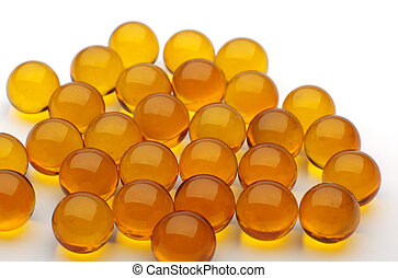 the heap of yellow pills on a white background