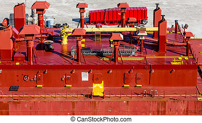 Yellow Pipes on Red Barge