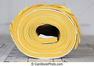 Yellow Plans - A photo of a roll of yellow plans.