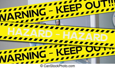 Yellow police tapes with Warning and Hazard text against ...