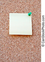 Yellow postit on a corkboard