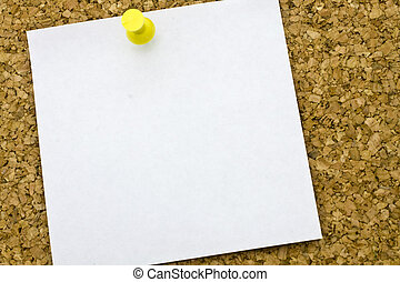 Yellow postit on a everyday corkboard. This is my corkboard.