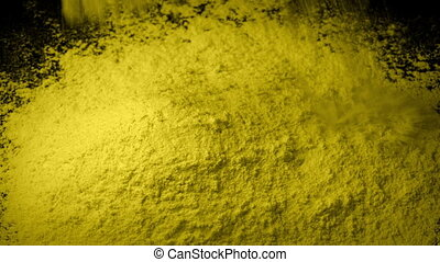 Yellow Powder Is Poured Into Pile - Yellow powder pours into...